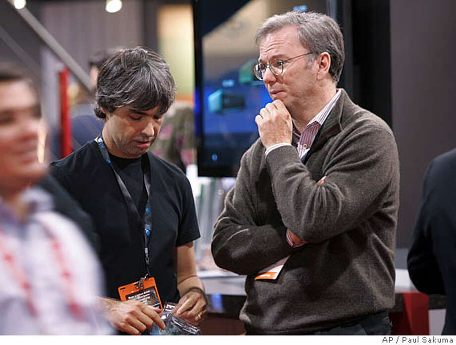 Google co-founder Larry Page, left, and Google CEO Eric Schmidt, right, chat at the Consumer Electronics Show (CES) in Las Vegas, Jan. 9, 2008. Google Inc. reports earnings for the first quarter after the market closes on Thursday, April 17, 2008. (AP Photo/Paul Sakuma) Photo: Paul Sakuma