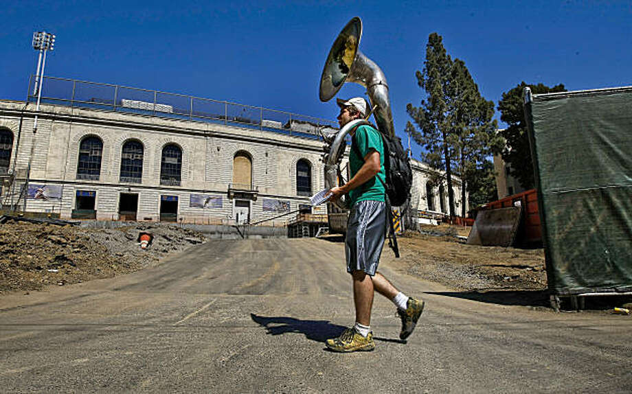 Student John Doylemason, a Sousaphone player on the Cal Marching band heads off to practice passing California Memorial Stadium on the UC Berkeley campus in Berkeley, Calif., on Thursday September 3, 2009, as  construction continues on the athletic training center on the West side, as fans attending Saturday's game will face many obstacles as the Bay Bridge will be closed, less parking and shuttle service scaled back. Photo: Michael Macor, The Chronicle