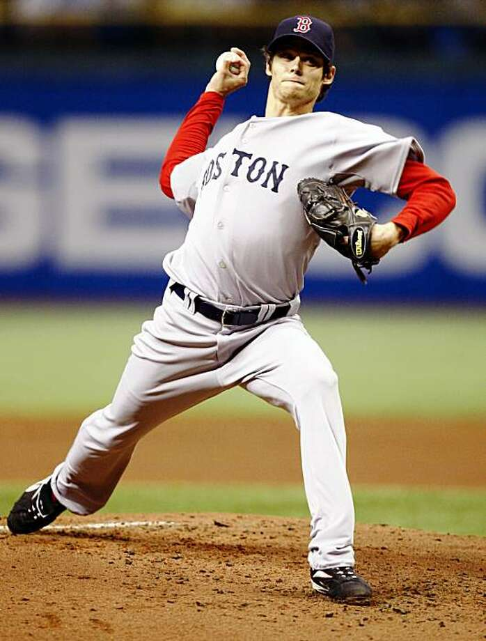 Boston Red Sox starting pitcher Clay Buchholz throws in the first inning of a baseball game against the Tampa Bay Rays Thursday, Sept. 3, 2009, in St. Petersburg, Fla. (AP Photo/Mike Carlson) Photo: Mike Carlson, AP