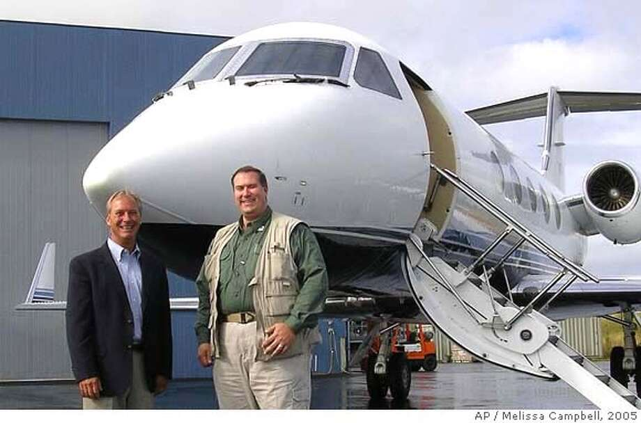 ** FILE ** Mark Avery, right, stands with Joe Kapper at Security Aviation Inc. in Anchorage, Alaska in 2005. Authorities shut down Security Aviation Inc. during a search at the company's Anchorage operations and at a hangar in Palmer, according to the FBI. Also searched was the office of Anchorage attorney Mark J. Avery, the sole shareholder who took over the company last summer. Robert F. Kane, 37, who is linked to the company, according to FBI agent Eric Gonzalez, was arrested Thursday, at his Eagle River home for failing to register an explosive device, which authorities identified as a rocket pod launcher used for firing live rounds, according to the FBI. (AP Photo/Alaska Journal of Commerce, Melissa Campbell, file ) 2005 FILE Photo: MELISSA CAMPBELL