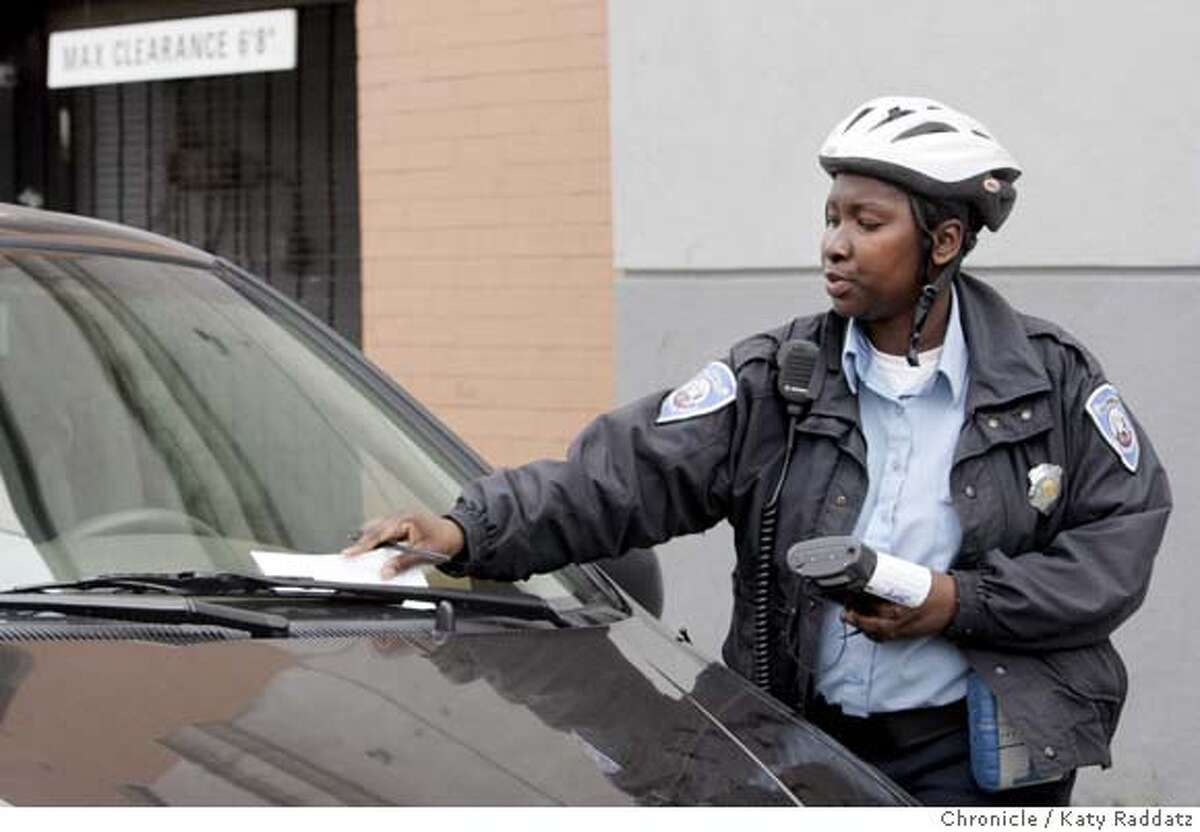 ###Live Caption:PARKING_101_RAD.jpg SHOWN: Parking officer #433 slaps a ticket on a vehicle on Howard St. Parking in San Francisco. These pictures were made on Tuesday, Jan. 30, 2007, in San Francisco, CA. (KATY RADDATZ/SFCHRONICLE)###Caption History:PARKING_101_RAD.jpg SHOWN: Parking officer #433 slaps a ticket on a vehicle on Howard St. Parking in San Francisco. These pictures were made on Tuesday, Jan. 30, 2007, in San Francisco, CA. (KATY RADDATZ/SFCHRONICLE) **###Notes:###Special Instructions:Mandatory credit for the photographer and the San Francisco Chronicle. No sales; mags out.