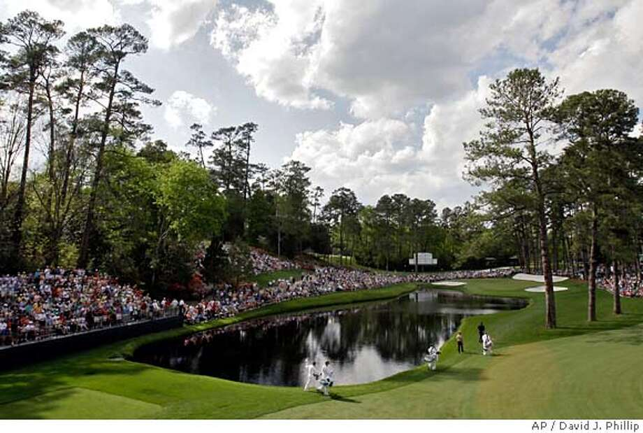 ###Live Caption:Gary Player of South Africa, lower left, waves to patrons after teeing off on the 16th hole during the second round of the 2008 Masters golf tournament at the Augusta National Golf Club in Augusta, Ga., Friday, April 11, 2008. (AP Photo/David J. Phillip)###Caption History:Gary Player of South Africa, lower left, waves to patrons after teeing off on the 16th hole during the second round of the 2008 Masters golf tournament at the Augusta National Golf Club in Augusta, Ga., Friday, April 11, 2008. (AP Photo/David J. Phillip)###Notes:Gary Player###Special Instructions: Photo: David J. Phillip