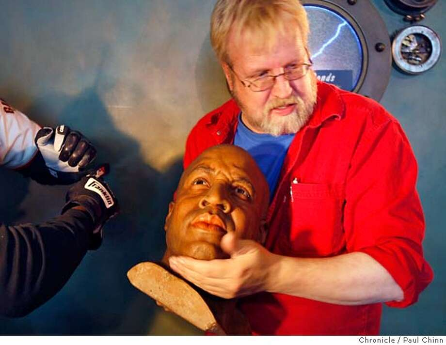 ###Live Caption:Curtis Huber cradles the wax likeness of former Giants slugger Barry Bonds at the Wax Museum in San Francisco, Calif., on Wednesday, April 16, 2008. Huber, the museum's curator, was relocating Bonds' figure from a coveted location in the lobby to the sports heroes wing downstairs in the main collection.  Photo by Paul Chinn / San Francisco Chronicle###Caption History:Curtis Huber cradles the wax likeness of former Giants slugger Barry Bonds at the Wax Museum in San Francisco, Calif., on Wednesday, April 16, 2008. Huber, the museum's curator, was relocating Bonds' figure from a coveted location in the lobby to the sports heros wing downstairs in the main collection.  Photo by Paul Chinn / San Francisco Chronicle###Notes:Curtis Huber###Special Instructions:MANDATORY CREDIT FOR PHOTOGRAPHER AND S.F. CHRONICLE/NO SALES - MAGS OUT Photo: Paul Chinn