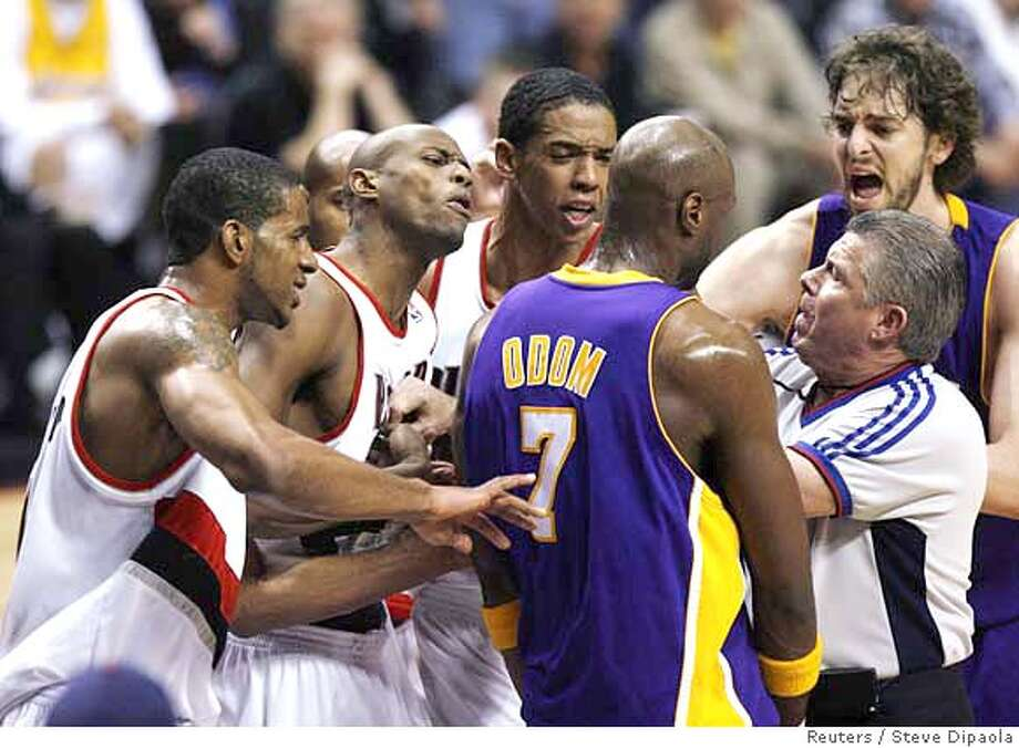 ###Live Caption:Portland Trail Blazers players (L to R) LaMarcus Aldridge, Travis Outlaw and Channing Frye react angrily to a flagrant foul by Los Angeles Lakers Lamar Odom (7) against Trail Blazer Brandon Roy (not pictured) during the third quarter of their NBA basketball game in Portland, Oregon April 8, 2008. Referee Bob Delaney and Pau Gasol (R) are also involved. REUTERS/Steve Dipaola (UNITED STATES)###Caption History:Portland Trail Blazers players (L to R) LaMarcus Aldridge, Travis Outlaw and Channing Frye react angrily to a flagrant foul by Los Angeles Lakers Lamar Odom (7) against Trail Blazer Brandon Roy (not pictured) during the third quarter of their NBA basketball game in Portland, Oregon April 8, 2008. Referee Bob Delaney and Pau Gasol (R) are also involved. REUTERS/Steve Dipaola (UNITED STATES)###Notes:Portland Trail Blazers players react angrily to a flagrant foul by Los Angeles Lakers during their NBA basketball game in Portland###Special Instructions:0 Photo: STEVE DIPAOLA