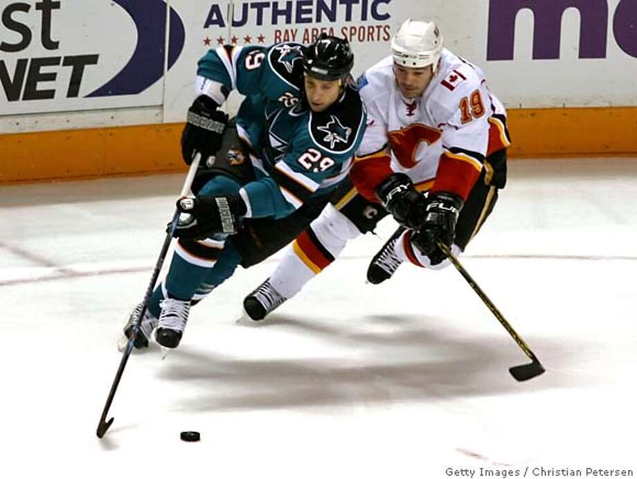 ###Live Caption:SAN JOSE, CA - APRIL 10: Ryane Clowe #29 of the San Jose Sharks skates with the puck under pressure from Wayne Primeau #19 of the Calgary Flames during game Two of the 2008 NHL conference quarter-final series at HP Pavilion on April 10, 2008 in San Jose, California. The Sharks defeated the Flames 2-0 to tie the series at 1-1. (Photo by Christian Petersen/Getty Images)###Caption History:SAN JOSE, CA - APRIL 10: Ryane Clowe #29 of the San Jose Sharks skates with the puck under pressure from Wayne Primeau #19 of the Calgary Flames during game Two of the 2008 NHL conference quarter-final series at HP Pavilion on April 10, 2008 in San Jose, California. The Sharks defeated the Flames 2-0 to tie the series at 1-1. (Photo by Christian Petersen/Getty Images)###Notes:Calgary Flames v San Jose Sharks - Game Two###Special Instructions: Photo: Christian Petersen