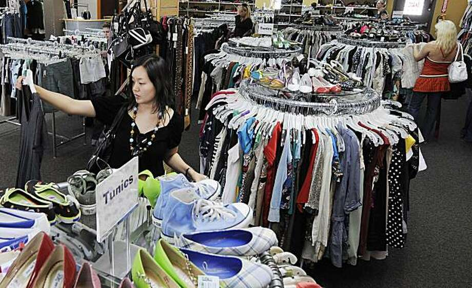 Jina Oh shops at the Buffalo Exchange store in the Sherman Oaks section of Los Angeles, Wednesday April 16, 2008.  Second-hand clothing chains like Buffalo Exchange have seen business surge this year as teens and their parents buy popular brands like Gap, Banana Republic and Juicy Couture at a fraction of the regular price.  (AP Photo/Kevork Djansezian) Photo: Kevork Djansezian, AP
