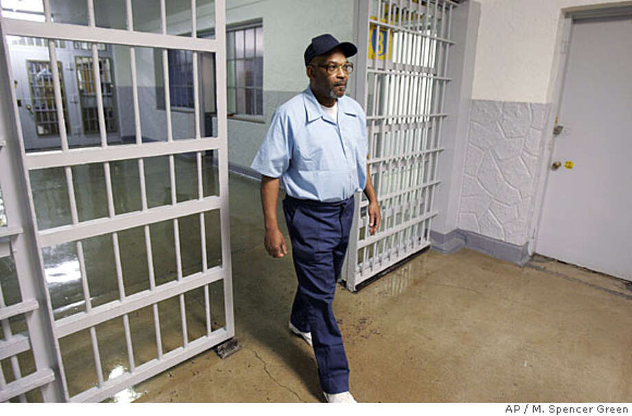 Inmate Alton Logan walks back to his cell after an interview with the Associated Press at Stateville Correctional Center in Joliet, Ill., Thursday, March, 27, 2008. Logan has been in prison for 26 years for a murder he claims he did not commit. Two lawyers for another inmate, Andrew Wilson, who died late last year, say their client confirmed in 1982 that he killed a security guard _ the crime for which Logan is serving a life sentence. Those lawyers recently came forward with an affidavit they signed 26 years ago declaring Logan was not responsible for the fatal shooting. (AP Photo/M. Spencer Green) Photo: M. Spencer Green