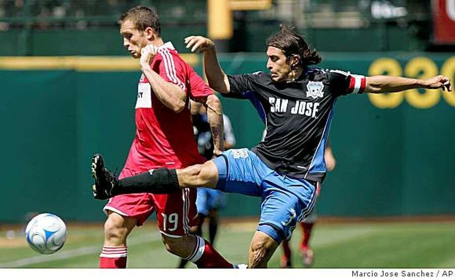 San Jose Earthquakes' Nick Garcia, right, defends Chicago Fire's Chad Barrett in the first half of an MLS soccer game in Oakland, Calif., Saturday, April 12, 2008. (AP Photo/Marcio Jose Sanchez) Photo: Marcio Jose Sanchez, AP