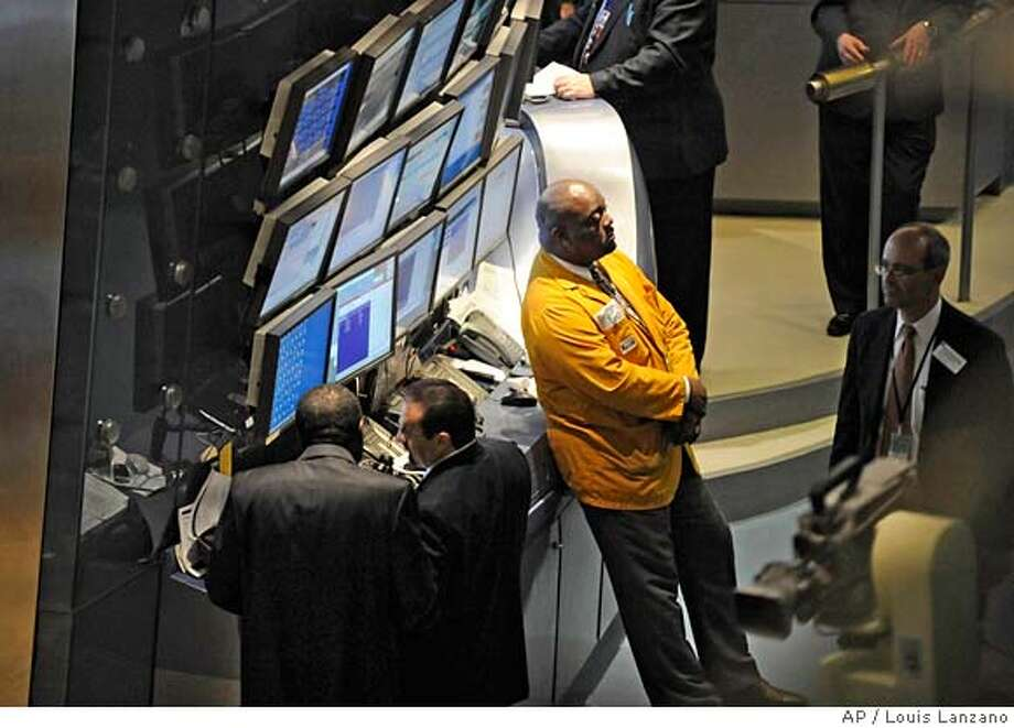 ###Live Caption:Traders work the floor of the New York Stock Exchange, Friday, April 11, 2008, in New York. Wall Street stumbled Friday after a disappointing first-quarter report from General Electric Co. surprised the market and stoked concern about the health of both corporate profits and the wider economy. (AP Photo/ Louis Lanzano)###Caption History:Traders work the floor of the New York Stock Exchange, Friday, April 11, 2008, in New York. Wall Street stumbled Friday after a disappointing first-quarter report from General Electric Co. surprised the market and stoked concern about the health of both corporate profits and the wider economy. (AP Photo/ Louis Lanzano)###Notes:###Special Instructions: Photo: Louis Lanzano