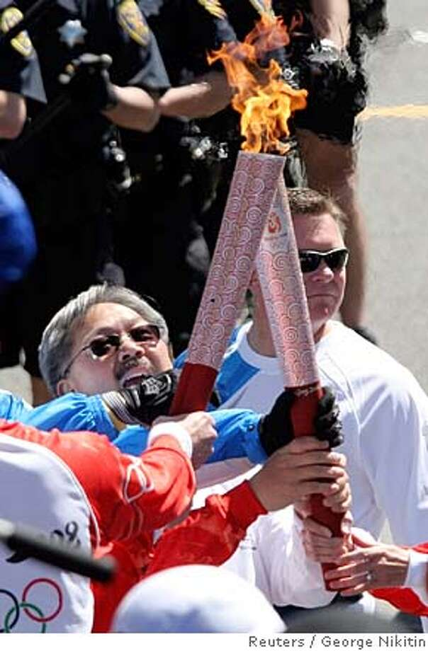 ###Live Caption:Olympic torch runner Ed Lee exchanges the flame during the Olympic Torch Relay April 9, 2008, in San Francisco. REUTERS/George Nikitin/Pool (UNITED STATES)###Caption History:Olympic torch runner Ed Lee exchanges the flame during the Olympic Torch Relay April 9, 2008, in San Francisco. REUTERS/George Nikitin/Pool (UNITED STATES)###Notes:Olympic torch runner Ed Lee exchanges the flame during Olympic torch run in San Francisco###Special Instructions:0 Photo: POOL
