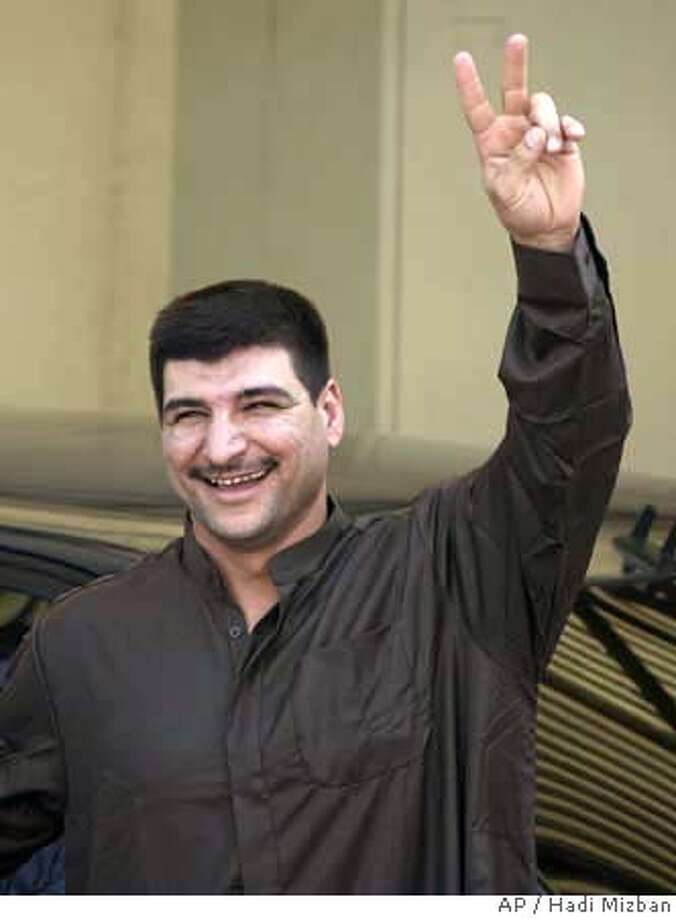###Live Caption:Associated Press photographer Bilal Hussein gestures after being released from a U.S. military prison in Baghdad, Iraq, Wednesday, April 16, 2008. The U.S. military released Hussein on Wednesday after holding him for more than two years without filing formal charges. (AP Photo/Hadi Mizban)###Caption History:Associated Press photographer Bilal Hussein gestures after being released from a U.S. military prison in Baghdad, Iraq, Wednesday, April 16, 2008. The U.S. military released Hussein on Wednesday after holding him for more than two years without filing formal charges. (AP Photo/Hadi Mizban)###Notes:###Special Instructions: Photo: Hadi Mizban