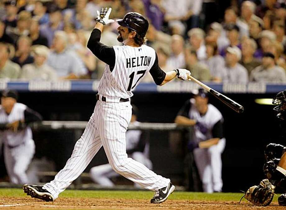 Colorado Rockies' Todd Helton connects for a  three-run home run against the New York Mets in the fourth inning of a baseball game in Denver on Tuesday, Sept. 1, 2009. (AP Photo/David Zalubowski) Photo: David Zalubowski, AP