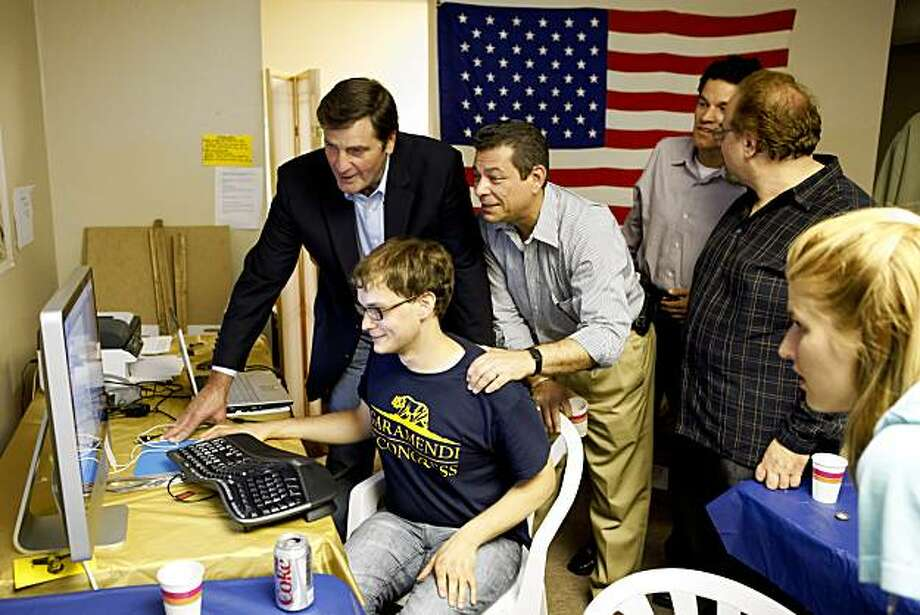John Garamendi, upper left, and volunteers watch results come in at his campaign headquarters in Walnut Creek, Calif., on Tuesday, September 1, 2009. Early on, Garamendi was leading in returns and awaiting more results of the special election for California's 10th Congressional District. Photo: Carlos Avila Gonzalez, The Chronicle