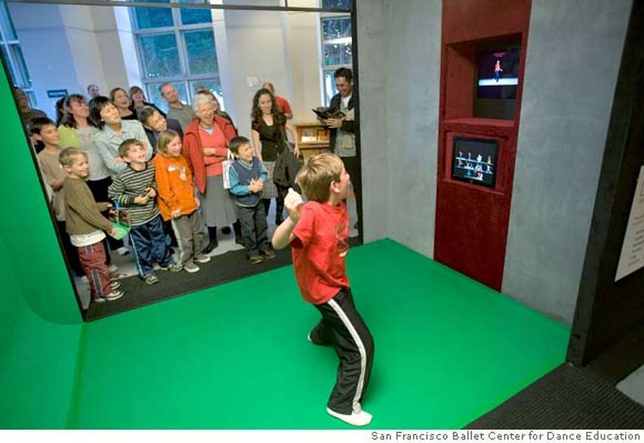 A 9 year-old boy becomes the first user of Dance-IT.  photo from: San Francisco Ballet Center for Dance Education  Dance IT at the SF LibraryMASTER IMAGE  2008 Event  Dance-IT at the San Francisco Public Library.  (� Chris Hardy) Photo: San Francisco Ballet Center For