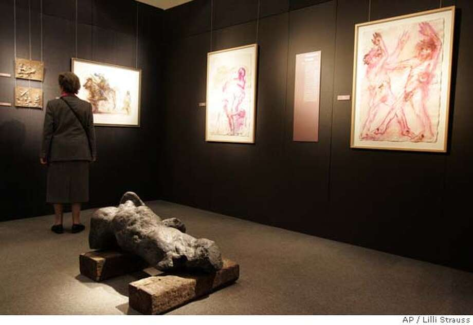 ###Live Caption:A visitor looks at artworks by Austrian artist Alfred Hrdlicka, on Friday, April 11, 2008, at the diocesan museum in Vienna. An outcry over an etching by Hrdlcka that depicts Jesus Christ and his disciples having an orgy during the biblical Last Supper prompted Austria's top Roman Catholic churchman to pull it from the museum. (AP Photo/Lilli Strauss)###Caption History:A visitor looks at artworks by Austrian artist Alfred Hrdlicka, on Friday, April 11, 2008, at the diocesan museum in Vienna. An outcry over an etching by Hrdlcka that depicts Jesus Christ and his disciples having an orgy during the biblical Last Supper prompted Austria's top Roman Catholic churchman to pull it from the museum. (AP Photo/Lilli Strauss)###Notes:###Special Instructions: Photo: Lilli Strauss