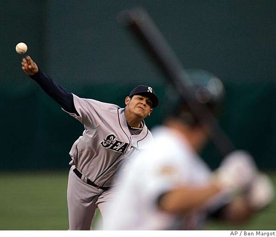 Seattle Mariners' Felix Hernandez releases a pitch to Oakland Athletics' Mark Ellis in the first inning of a baseball game Wednesday, April 16, 2008, in Oakland, Calif. (AP Photo/Ben Margot) Photo: Ben Margot