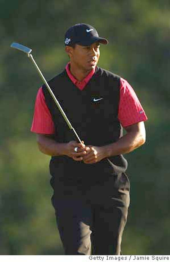 ###Live Caption:AUGUSTA, GA - APRIL 13: Tiger Woods walks to the 18th green during the final round of the 2008 Masters Tournament at Augusta National Golf Club on April 13, 2008 in Augusta, Georgia. (Photo by Jamie Squire/Getty Images)###Caption History:AUGUSTA, GA - APRIL 13: Tiger Woods walks to the 18th green during the final round of the 2008 Masters Tournament at Augusta National Golf Club on April 13, 2008 in Augusta, Georgia. (Photo by Jamie Squire/Getty Images)###Notes:The Masters - Final Round###Special Instructions: Photo: Jamie Squire