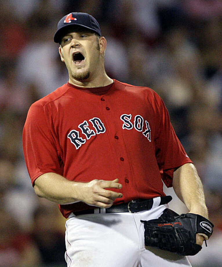 Boston Red Sox starting pitcher Brad Penny reacts after a ground-rule double hit  by New York Yankees'  Eric Hinske in the second inning of their baseball game at Fenway Park in Boston, Friday, Aug. 21, 2009. (AP Photo/Elise Amendola) Photo: Elise Amendola, AP