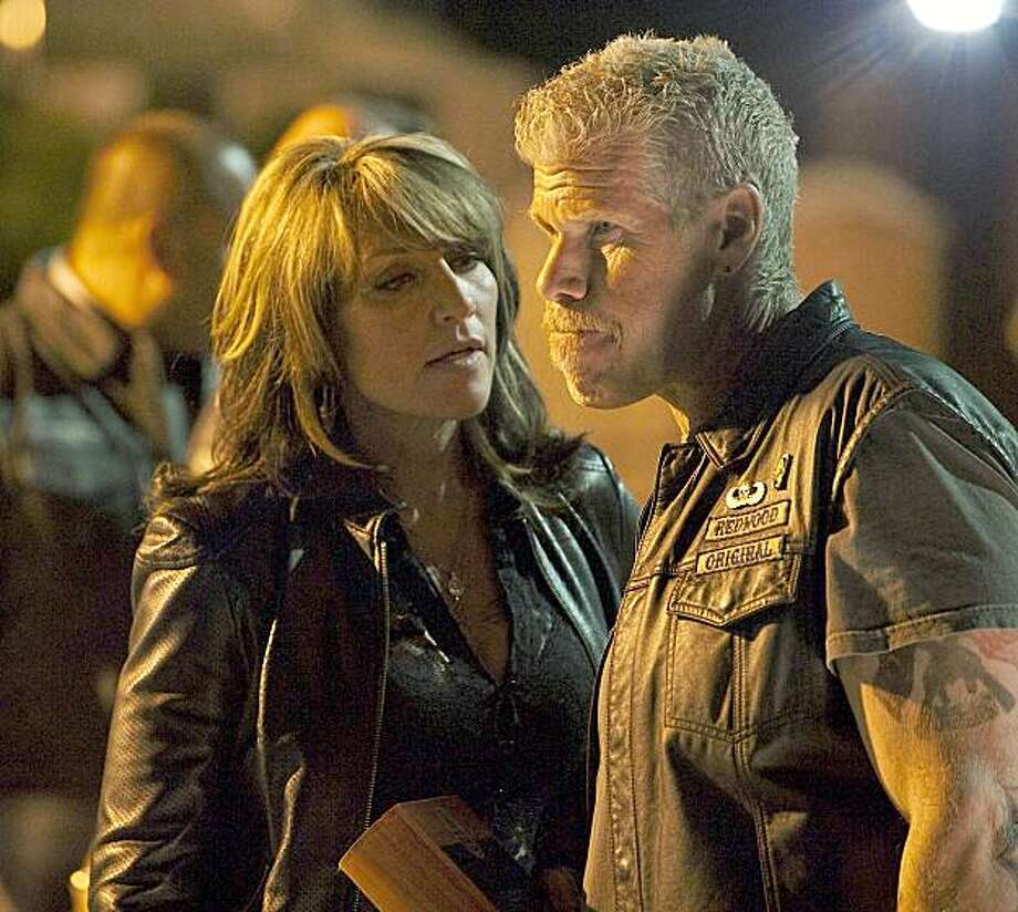 "SONS OF ANARCHY: 201: L-R: Katey Sagal as Gemma Teller and Ron Perlman as Clay Morrow on the episode ""Albification"" airing Tuesday, Sept. 8th, 10 pm e/p on FX. CR: Prashant Gupta / FX Photo: Prashant Gupta, FX"