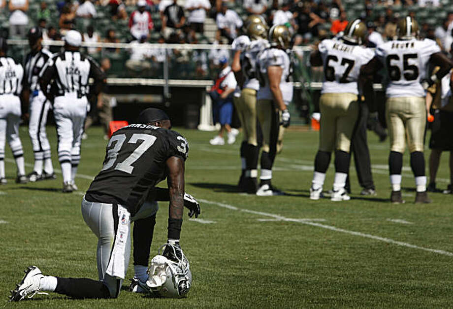 Cornerback Chris Johnson shows his frustration after another Raiders turnover in the second quarter of the Oakland Raiders vs. New Orleans pre-season football game at the Coliseum in Oakland, Calif., on Saturday, Aug. 29, 2009. Photo: Paul Chinn, The Chronicle