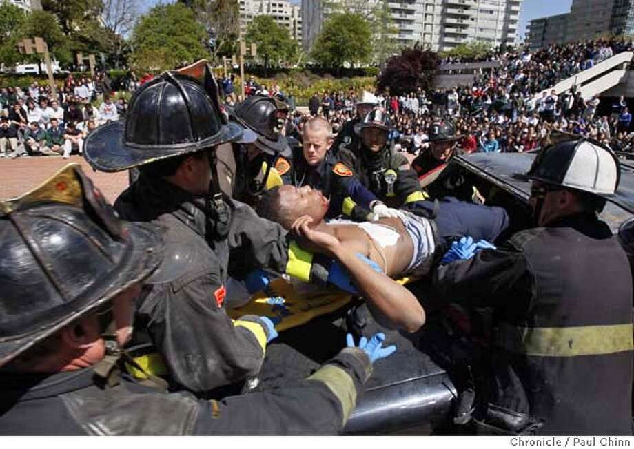 ###Live Caption:Firefighters tend to Kevin Greene, a fatality in a simulated fatal traffic accident, at Sacred Heart Cathedral Preparatory School in San Francisco, Calif., on Tuesday, April 15, 2008. Law enforcement officials staged the scenario to demonstrate the consequences of drinking and driving to the entire student body.  Photo by Paul Chinn / San Francisco Chronicle###Caption History:Firefighters tend to Kevin Greene, a fatality in a simulated fatal traffic accident, at Sacred Heart Cathedral Preparatory School in San Francisco, Calif., on Tuesday, April 15, 2008. Law enforcement officials staged the scenario to demonstrate the consequences of drinking and driving to the entire student body.  Photo by Paul Chinn / San Francisco Chronicle###Notes:Kevin Greene###Special Instructions:MANDATORY CREDIT FOR PHOTOGRAPHER AND S.F. CHRONICLE/NO SALES - MAGS OUT Photo: Paul Chinn