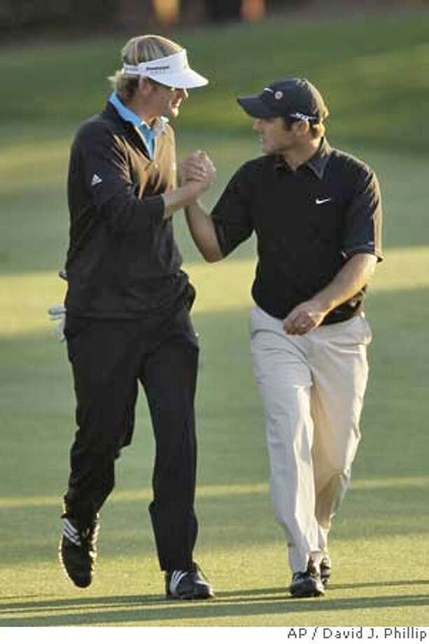 ###Live Caption:Trevor Immelman, right, of South Africa is congratulated by Brandt Snedeker as they walk up the 18th fairway during the final round of the 2008 Masters golf tournament at the Augusta National Golf Club in Augusta, Ga., Sunday, April 13, 2008. Immelman won the Masters tournament. (AP Photo/David J. Phillip)###Caption History:Trevor Immelman, right, of South Africa is congratulated by Brandt Snedeker as they walk up the 18th fairway during the final round of the 2008 Masters golf tournament at the Augusta National Golf Club in Augusta, Ga., Sunday, April 13, 2008. Immelman won the Masters tournament. (AP Photo/David J. Phillip)###Notes:Trevor Immelman, Brandt Snedeker###Special Instructions: Photo: David J. Phillip