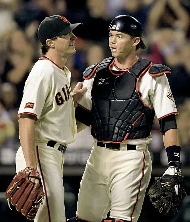 Barry Zito (left) ran into his catcher Eli Whiteside (right) in the ninth inning as he make a infield play for an out in the ninth inning and then when on to be the winning pitcher over Colorado Rockies at AT&T Park on August 29, 2009. Photo: Frederic Larson, The Chronicle
