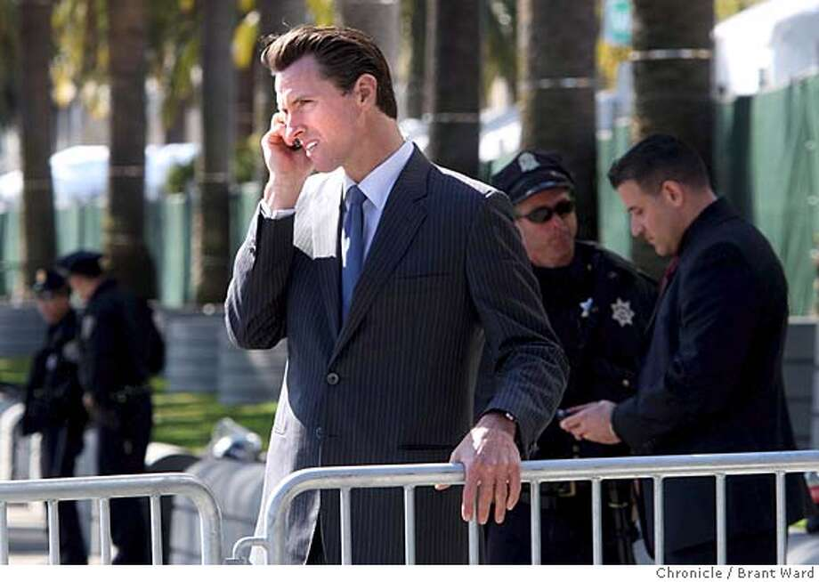 Mayor Gavin Newsom was using his cell phone as he viewed the scene on Market Street before the torch run. Thousands of protesters on both sides of the China issue protested near the Ferry building in San Francisco Wednesday, April 9, 2008. Photo by Brant Ward / San Francisco Chronicle  Ran on: 04-11-2008  Mayor Gavin Newsom was on his cell phone Wednesday as he viewed the scene on Market Street before the torch relay began.  Ran on: 04-11-2008  Mayor Gavin Newsom was on his cell phone Wednesday as he viewed the scene on Market Street before the torch relay began. Photo: Brant Ward