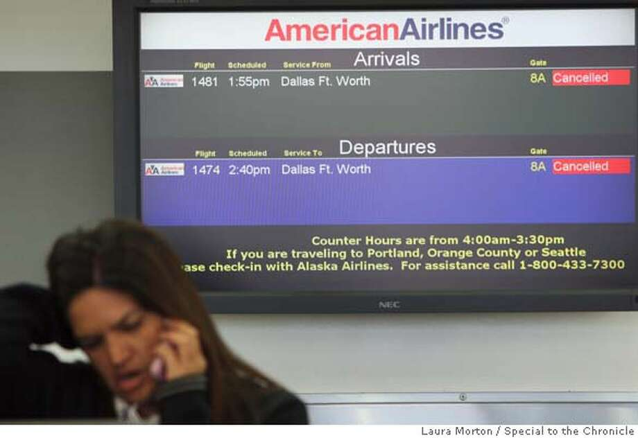 ###Live Caption:An American Airlines ticket agent talks on the phone underneath a sign announcing canceled flights at Oakland International Airport in Oakland, Calif., on Wednesday, April 9, 2008. Photo by Laura Morton / Special to The Chronicle###Caption History:An American Airlines ticket agent talks on the phone underneath a sign announcing canceled flights at Oakland International Airport in Oakland, Calif., on Wednesday, April 9, 2008. Photo by Laura Morton / Special to The Chronicle###Notes:###Special Instructions: Photo: Laura Morton