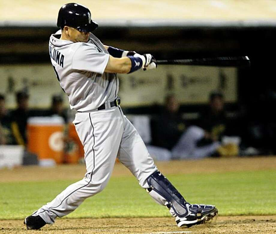 Seattle Mariners' Kenji Johjima, of Japan, hits a two-run home run off of Oakland Athletics' Brett Tomko in the fourth inning of a baseball game on Thursday, Sept. 3, 2009, in Oakland, Calif. (AP Photo/Jeff Chiu) Photo: Jeff Chiu, AP