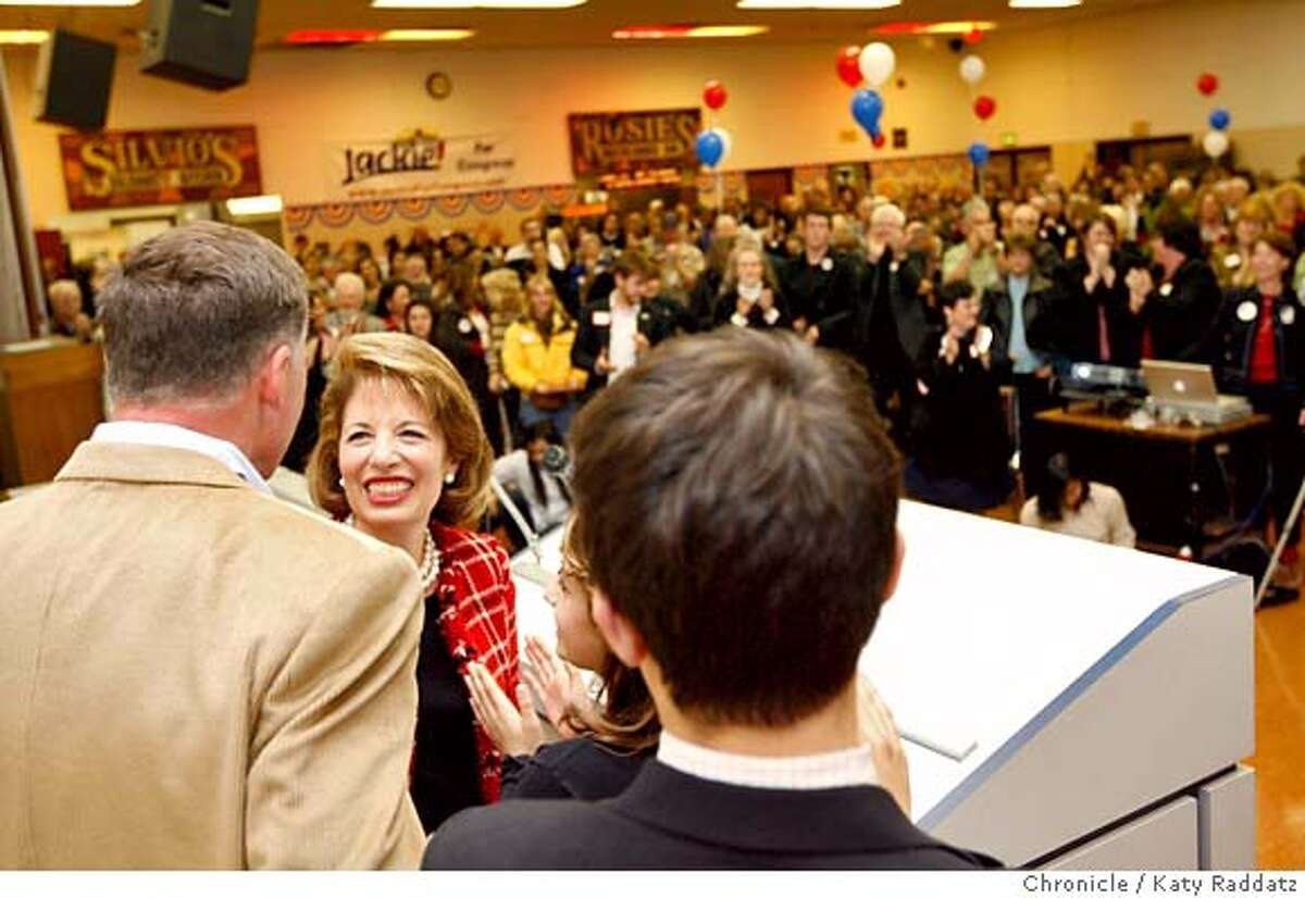 ###Live Caption:Jackie Speier turns her smiling face happily to her husband and children on the podium just before her speech at a victory celebration for Jackie Speier's congressional campaign at the Machinists' Union Hall in Burlingame, Calif. on Tuesday, April 8, 2008. Photo by Katy Raddatz / San Francisco Chronicle###Caption History:Jackie Speier turns her smiling face happily to her husband and children on the podium just before her speech at a victory celebration for Jackie Speier's congressional campaign at the Machinists' Union Hall in Burlingame, Calif. on Tuesday, April 8, 2008. Photo by Katy Raddatz / San Francisco Chronicle###Notes:Jackie Speier (cq)###Special Instructions:MANDATORY CREDIT FOR PHOTOG AND SAN FRANCISCO CHRONICLE/NO SALES-MAGS OUT