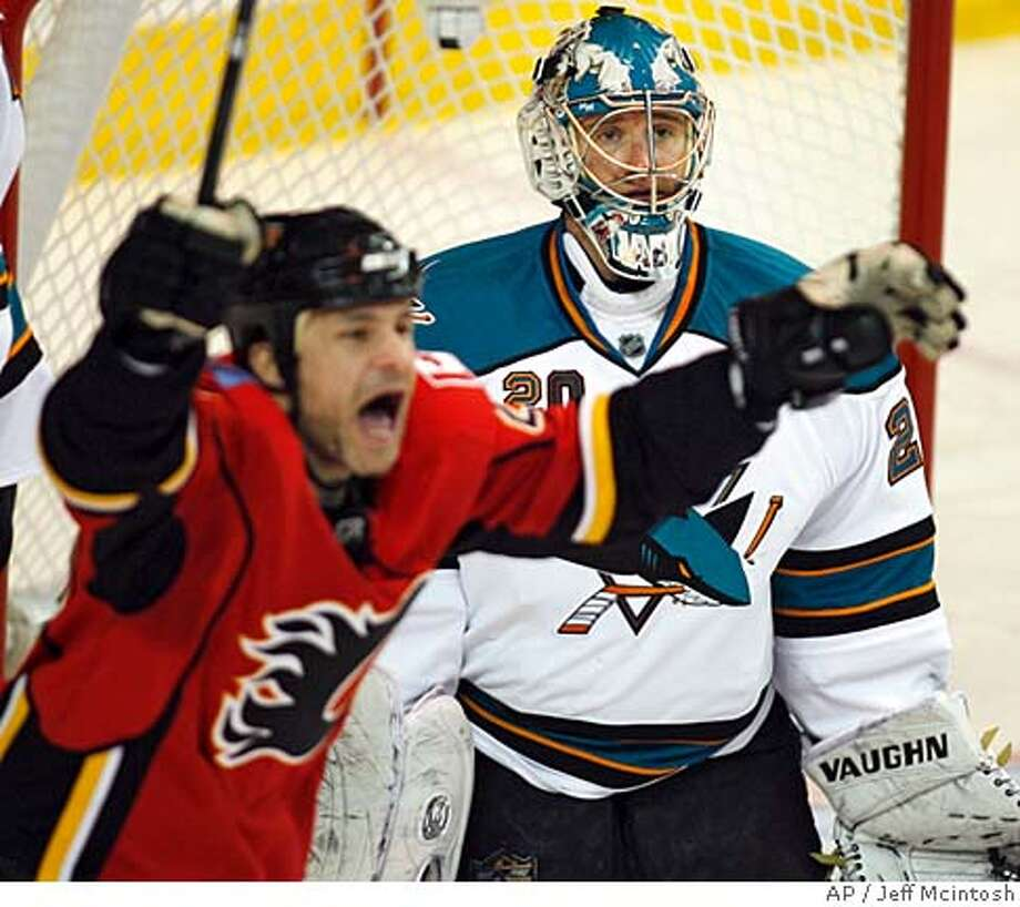San Jose Sharks' goalie Evgeni Nabokov, right, of Kazakhstan, reacts to letting in the game winning goal as Calgary Flames' Daymond Langkow celebrates during the third period of an NHL Western Conference playoff series game in Calgary, Alberta, Sunday, April 13, 2008. The Flames beat the Sharks 4-3 to take the lead in the best of seven series 2-1. (AP Photo/The Canadian Press, Jeff McIntosh) Photo: Jeff McIntosh