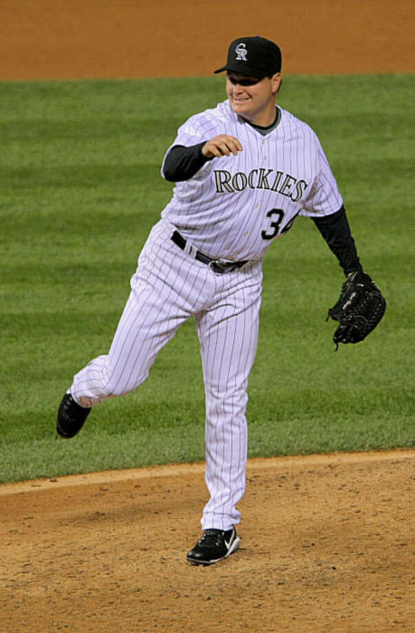 DENVER - AUGUST 25:  Relief pitcher Matt Herges #34 of the Colorado Rockies works against  the Los Angeles Dodgers in the 10th inning at Coors Field on August 25, 2009 in Denver, Colorado. Herges picked up the win as the Rockies defeated the Dodgers 5-4.  (Photo by Doug Pensinger/Getty Images) *** Local Caption *** Matt Herges Photo: Doug Pensinger, Getty Images