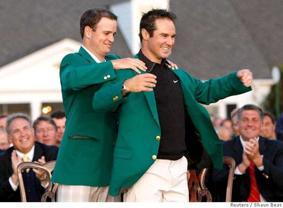 Trevor Immelman (R) of South Africa receives the green jacket from former champion Zach Johnson after Immelman won the 2008 Masters golf tournament at the Augusta National Golf Club in Augusta, Georgia, April 13, 2008. REUTERS/Shaun Best (UNITED STATES) Photo: SHAUN BEST