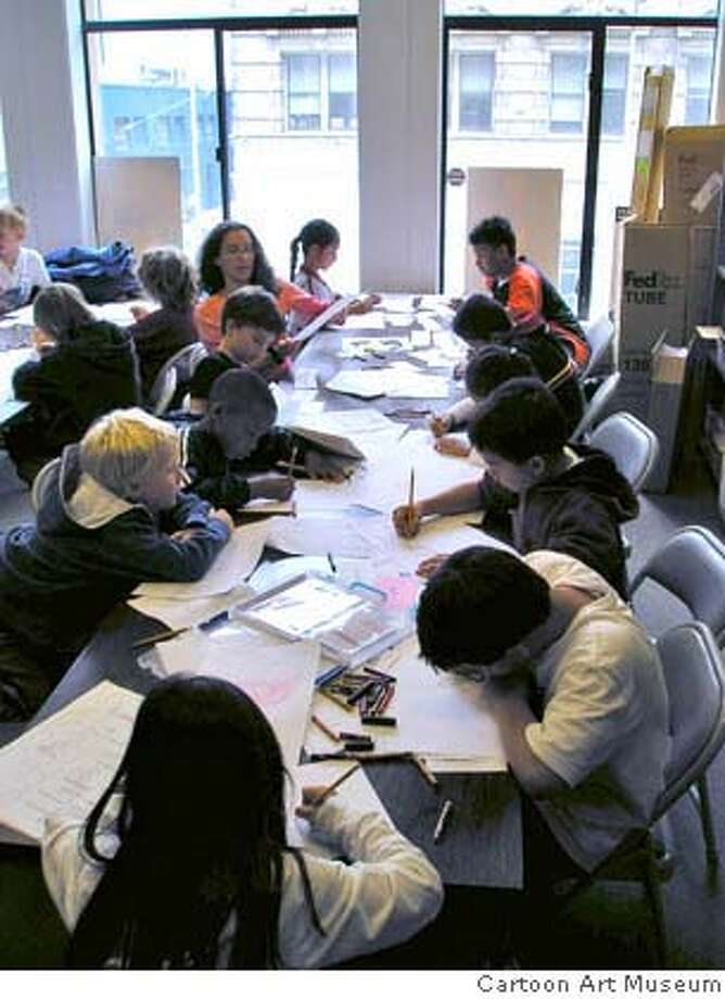 Children participating in the Cartooning Class at the Cartoon Art Museum.  OLYMPUS DIGITAL CAMERA Photo: Cartoon Art Museum