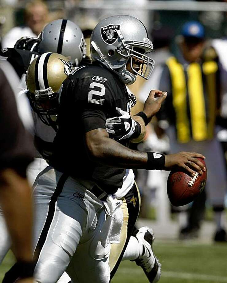 Quarterback JaMarcus Russell is sacked in the second quarter of the Oakland Raiders vs. New Orleans pre-season football game at the Coliseum in Oakland, Calif., on Saturday, Aug. 29, 2009. Photo: Paul Chinn, The Chronicle