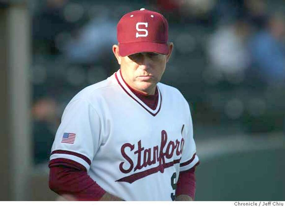 ###Live Caption:adf###Caption History:IRONMAN3A-C-03MAY02-SP-JC-- Stanford baseball coach Mark Marquess, who has coached the baseball team for over 26 years, leads the team as the Stanford Cardinal host the Cal Bears on Friday evening at Stanford. Photo by Jeff Chiu / The Chronicle.###Notes:###Special Instructions: Photo: Jeff Chiu