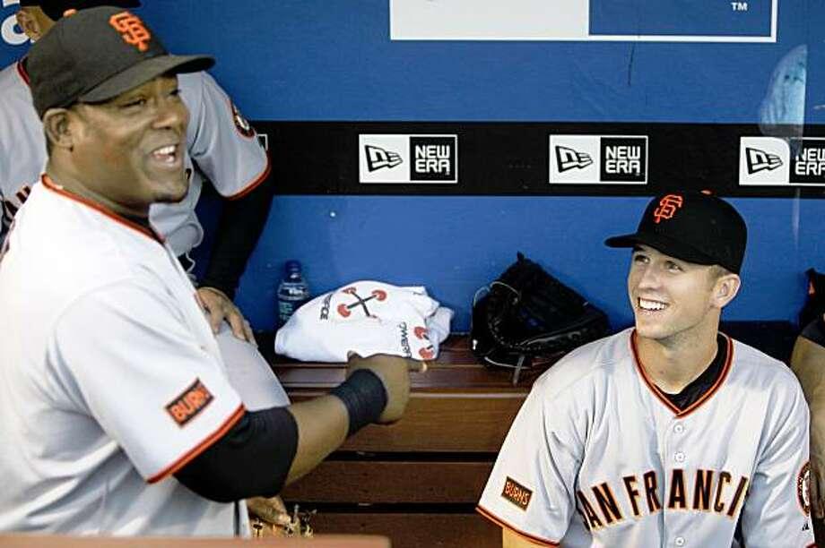 San Francisco Giants third baseman Juan Uribe, left, and catcher Buster Posey laugh before a baseball game against the Philadelphia Phillies, Wednesday, Sept. 2,2009, in Philadelphia. (AP Photo/Matt Slocum) Photo: Matt Slocum, AP