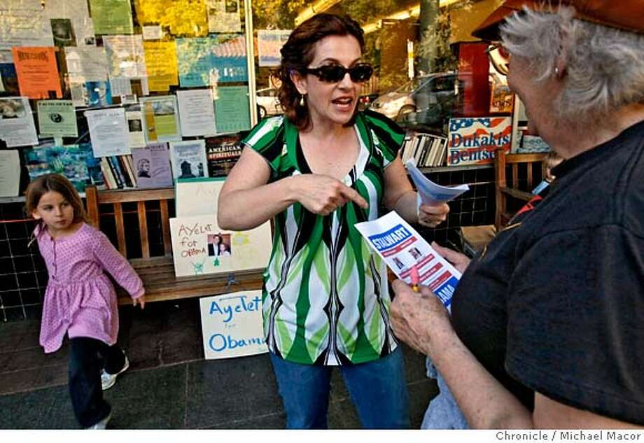 ###Live Caption:Ayelet Waldman, and her daughter Rosie, encourages Crisley Bauer to vote for her in front of the Star Grocery store on Claremont Avenue in Berkeley, Calif. on April 11, 2008. Waldman is vying to become a delegate at the Democratic national convention in Denver. Photo by Michael Macor/ San Francisco Chronicle###Caption History:Ayelet Waldma encourages Crisley Bauer to vote for her as a delegate for presidential candidate Barack Obama in this Sundays caucus. Waldman stumps for votes in front of the Star Grocery on Clarement Ave. in Berkeley, Calif., on April 11, 2008. Her daughter Rosie helps with the campaign.  Photo by Michael Macor/ San Francisco Chronicle###Notes:The latest sign that peopel are going nuts to get involved in the presidential campaign, where a record number of people applied for the privegae of paying $2,500 of thier own money to travel to Denver to be a delegate to the Democratic national conventi###Special Instructions:Mandatory credit for Photographer and San Francisco Chronicle No sales/ Magazines Out Photo: Michael Macor