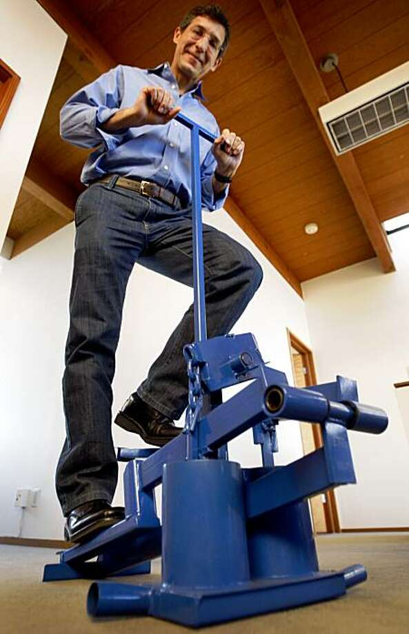 Martin Fisher, CEO and co-founder of KickStart, displays the foot-powered water pump, that his company developed and sells to farmers in Africa. Photo: Paul Chinn, The Chronicle