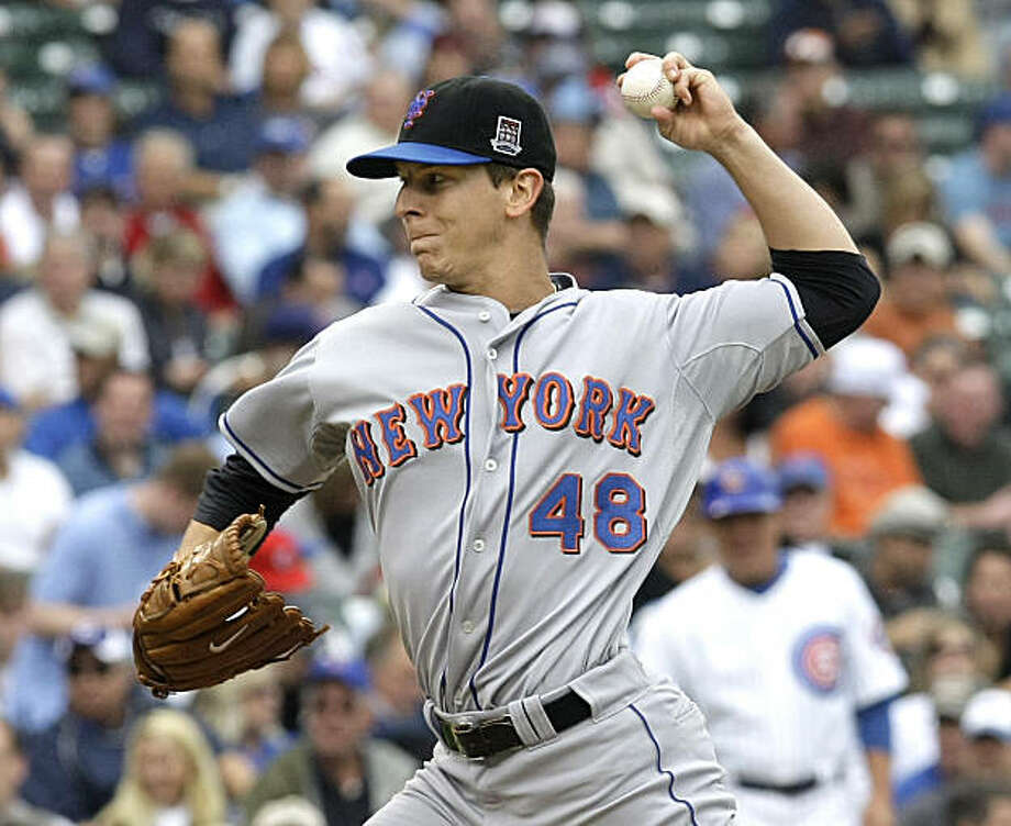 New York Mets relief pitcher Patrick Misch delivers during the first inning of a baseball game against the Chicago Cubs Friday, Aug. 28, 2009 at Wrigley Field in Chicago. (AP Photo/Charles Rex Arbogast) Photo: Charles Rex Arbogast, AP