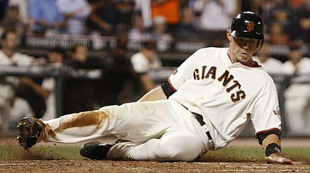 San Francisco Giants' Eli Whiteside slides to score against the Colorado Rockies during the sixth inning of a baseball game Friday, Aug. 28, 2009, in San Francisco. Whiteside scored on a base hit by Eugenio Velez. (AP Photo/Ben Margot) Photo: Ben Margot, AP