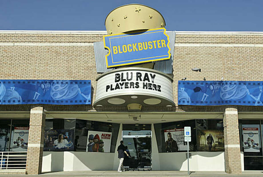 An employee walks into a Blockbuster store, Monday, April 14, 2008, in Dallas. Blockbuster Inc. said Monday it has offered to pay more than $1 billion for struggling Circuit City Stores Inc., but the nation's second biggest consumer electronics chain questioned whether the movie-rental company can finance the deal. (AP Photo/Matt Slocum) Photo: Matt Slocum, AP