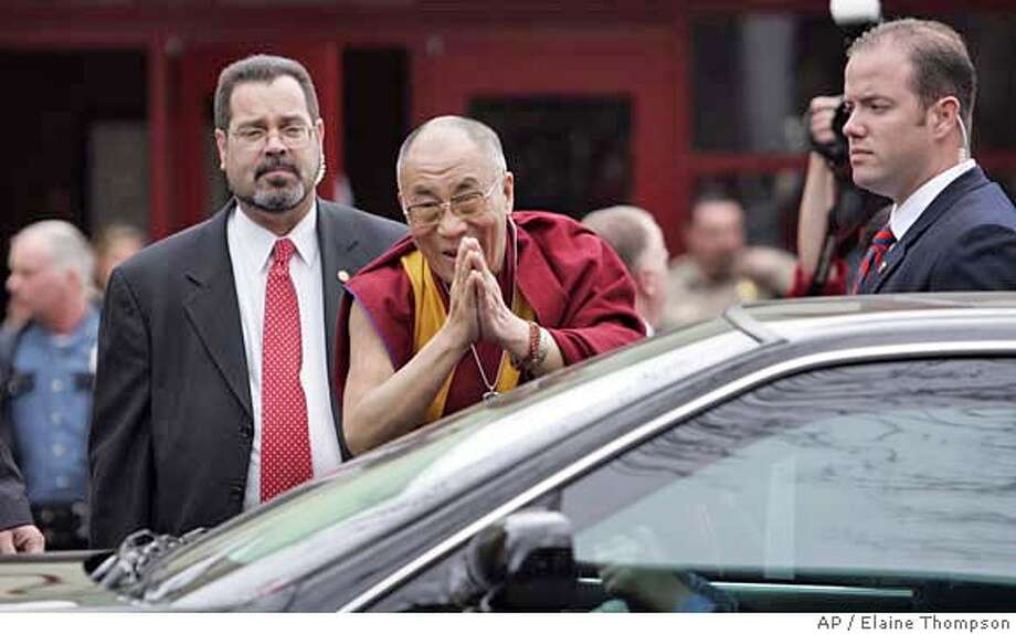 ###Live Caption:The Dalai Lama, center, motions to a small crowd standing nearby as he heads into a car after participating in a panel discussion about philanthropy Sunday, April 13, 2008, in Seattle. The Dalai Lama is headlining a five-day conference in Seattle featuring dozens of workshops on various subjects related to compassion, hosted by the organization Seeds of Compassion. (AP Photo/Elaine Thompson)###Caption History:The Dalai Lama, center, motions to a small crowd standing nearby as he heads into a car after participating in a panel discussion about philanthropy Sunday, April 13, 2008, in Seattle. The Dalai Lama is headlining a five-day conference in Seattle featuring dozens of workshops on various subjects related to compassion, hosted by the organization Seeds of Compassion. (AP Photo/Elaine Thompson)###Notes:Dalai Lama###Special Instructions: Photo: Elaine Thompson