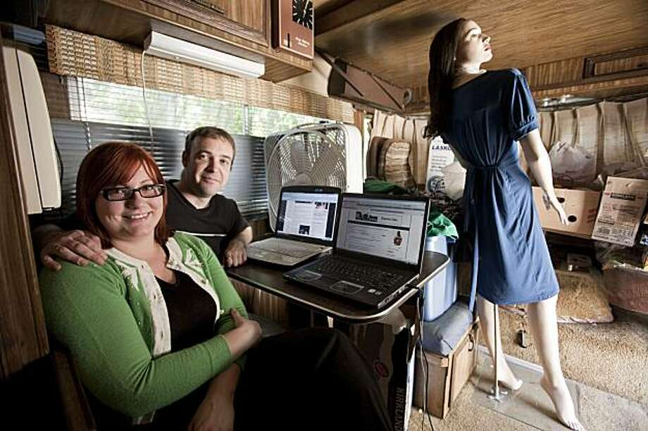 This photo taken Aug. 28, 2009 shows Brianna Karp, left, and her boyfriend, Matt Barnes, both bloggers, posing  in an RV that they are living in Riverside, Calif.(AP Photo/Francis Specker) Photo: Francis Specker, AP