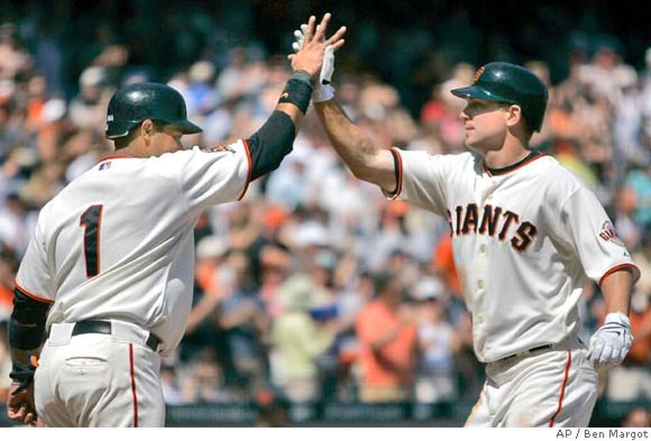 San Francisco Giants' John Bowker, right, is congratulated by teammate Bengie Molina (1) after hitting a two run home run off St. Louis Cardinals' Joel Pineiro during the fourth inning of a baseball game Saturday, April 13, 2008, in San Francisco. Bowker scored on a single by pitcher Tim Lincecum. (AP Photo/Ben Margot) Photo: Ben Margot