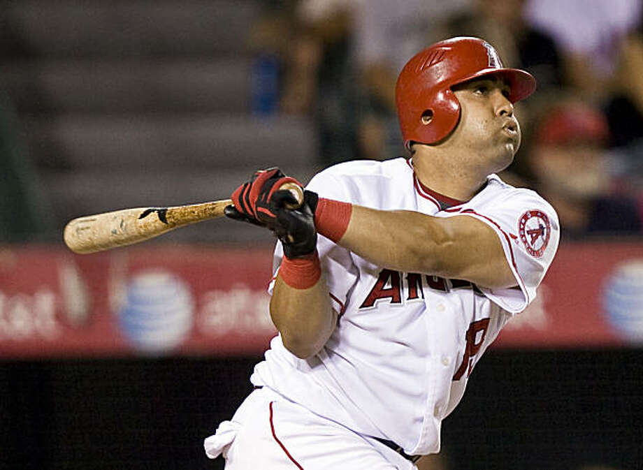 Kendry Morales hits a three-run home run to give the Los Angeles Angels the lead against the Oakland Athletics in the seventh inning of a baseball game in Anaheim, Calif., Friday, Aug. 28, 2009. (AP Photo/Mark Avery) Photo: Mark Avery, AP