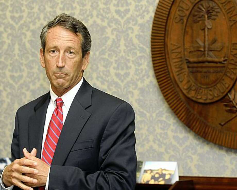 S.C. Gov.Mark Sanford announces that he will not resign at a news conference in Columbia, S.C. Wednesday, Aug. 26, 2009. (AP Photo/Virginia Postic) Photo: Virginia Postic, AP