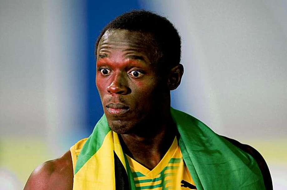 BERLIN - AUGUST 22:  Usain Bolt of Jamaica looks on after winning the gold medal in the men's 4x100 Metres Relay Final during day eight of the 12th IAAF World Athletics Championships at the Olympic Stadium on August 22, 2009 in Berlin, Germany.  (Photo by Alexander Hassenstein/Bongarts/Getty Images) Photo: Alexander Hassenstein, Bongarts/Getty Images