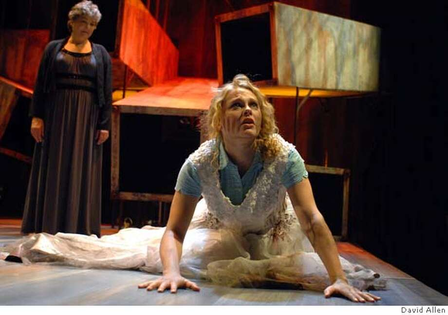 """###Live Caption:Hecuba (left), played by Carla Spindt, observes the terror of her daughter Cassandra (Sarah Nealis) in the Aurora Theatre production of Ellen McLaughlin's adaptation of """"The Trojan Women.""""###Caption History:Hecuba (left), played by Carla Spindt, observes the terror of her daughter Cassandra (Sarah Nealis) in the Aurora Theatre production of Ellen McLaughlin's adaptation of """"The Trojan Women.""""###Notes:All names cq###Special Instructions: Photo: David Allen"""